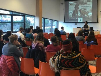 """[Image: Nyeema Harris of the University of Michigan gives a BRiDGE2Impacts presentation entitled """"The Fierce Urgency of Now to Redefine Impact in Academia"""" at the University of Massachusetts Amherst in October 2018. Credit: Benjamin Keisling]"""
