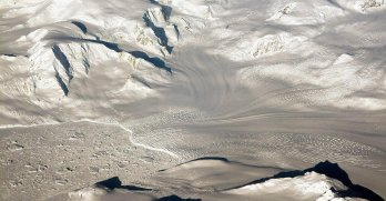Glaciers and mountains in the evening sun are seen on an Operation IceBridge research flight, returning from West Antarctica. Credit: Sipa US / Alamy Stock Photo