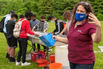 """Christine Hatch, UMass extension associate professor in geosciences, talks about the """"stream table"""" during the Climate Change Carnival at Amherst Regional Middle School. Source: Hampshire Gazette STAFF PHOTOS/CAROL LOLLIS"""