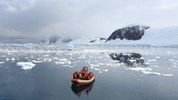 A boat floats in Neko Harbour, Antarctica, in February 2018.  Alexandre Meneghini / Reuters