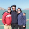 Dr. Leckie, Benjamin Keisling, and post-doc smiling at camera on deck of ship overlooking ocean